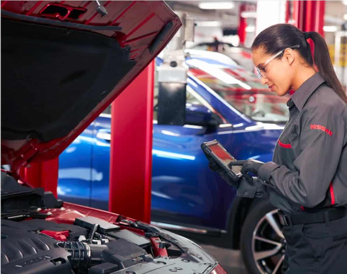 Service technician inspecting vehicle